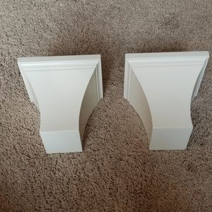 Two white small decorative shelves